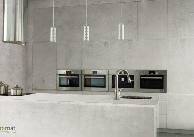 Cuisine design dont l'ameublement, la crédence et les murs sont habillés de feuille de béton