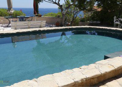 Réalisation bassin de piscine en feuille de pierre vue gauche